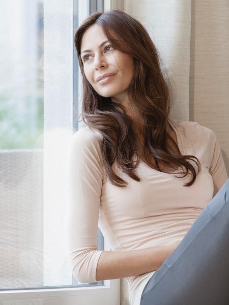 woman leaning on upvc window